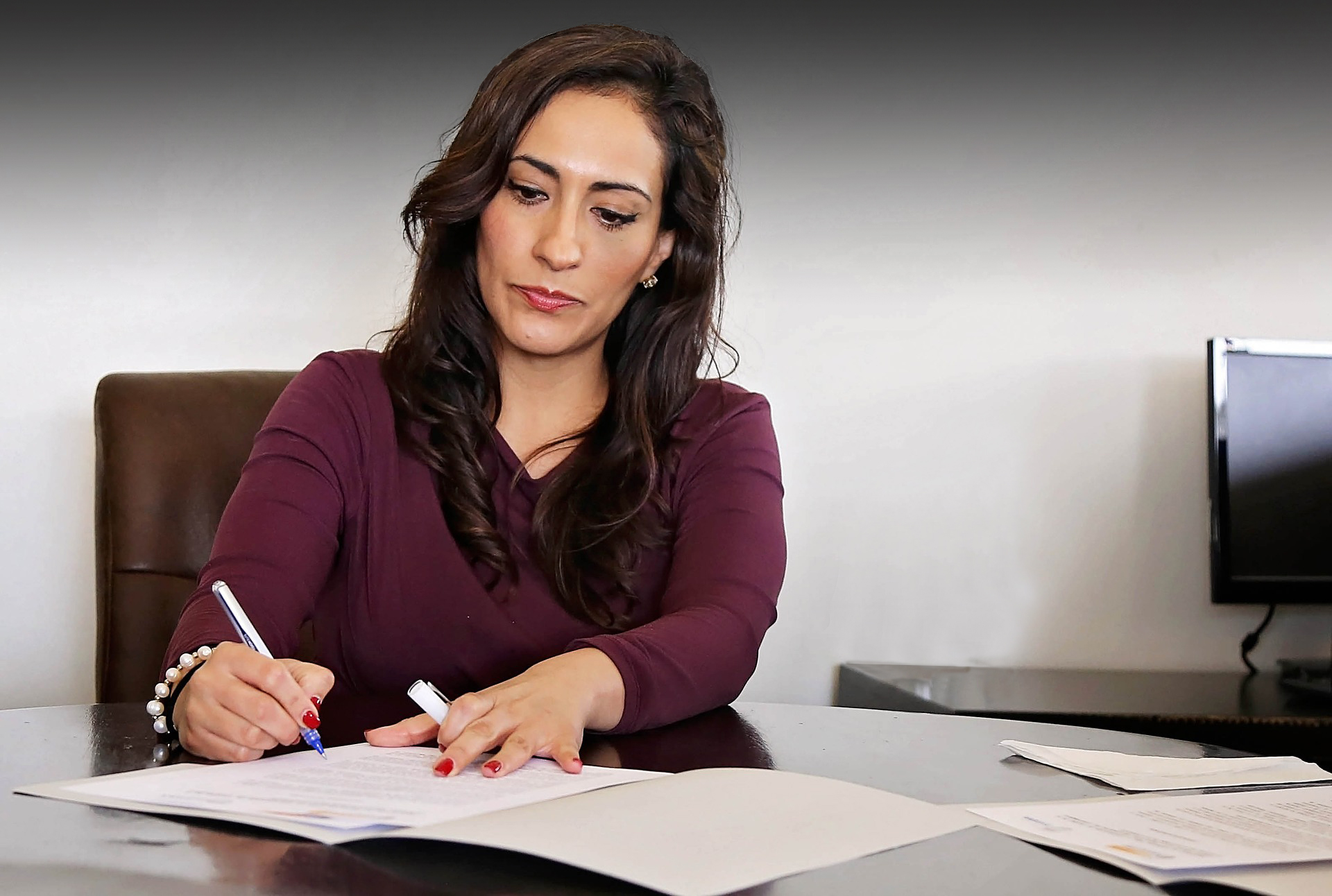 Woman writing on documents